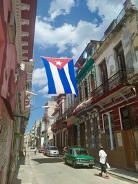 Street of Havana with Cuban flag flying